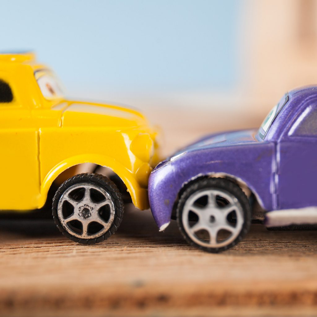 image of two toy cars in accident, illustrating IIHS top safety picks testing in a lab