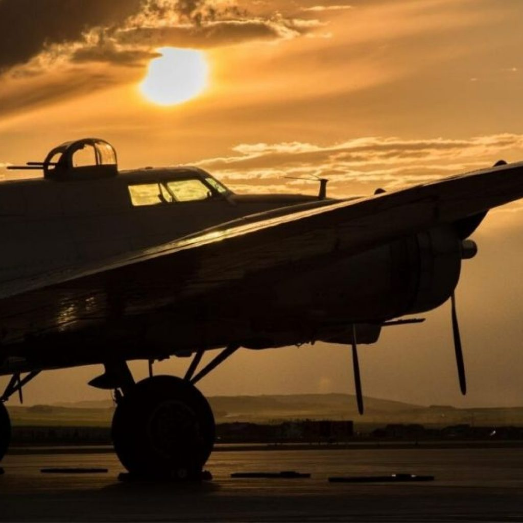 image of a b17 bomber at sunset. airplane crash tests led to seat belt safety history.