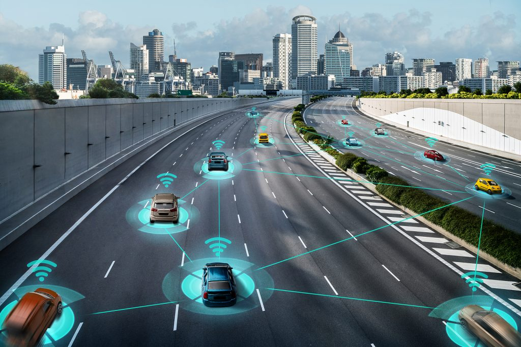 Illustration of cars on a highway, using driver assistance systems heading into a city.